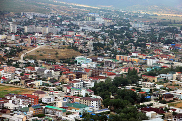 panorama bird eye view from the top to small town Sudak with colorful houses in valley in Crimea