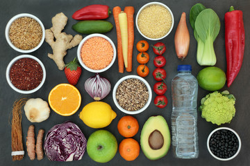 Health food for liver detox concept with fresh fruit, vegetables, legumes, grains, seeds, water, herbs and spices. Foods high in antioxidants, vitamins &  dietary fibre. Top view on slate.
