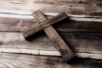 wooden cross on wooden table