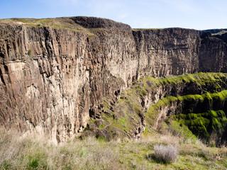 Basalt column rock formations at Palouse Falls, Washington state, USA, with hiking trail running along the canyon wall