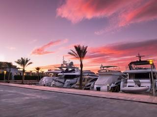 Luxury yachts moored in Abu Tig Marina in El Gouna, Egypt at sunset
