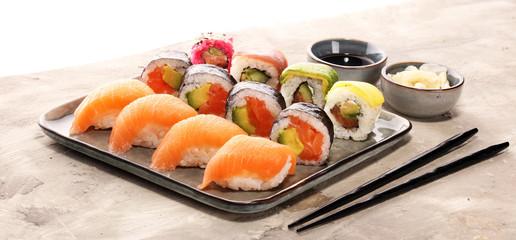 Printed roller blinds Sushi bar close up of sashimi sushi set with chopsticks and soy - sushi roll with salmon and sushi roll with smoked eel