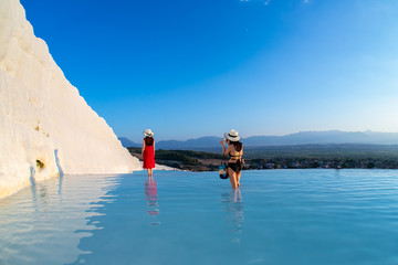 girl photographs a girl in a red dress on pamukkale