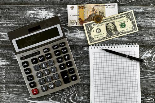 Calculator Notebook Pen And Money Exchange Rates