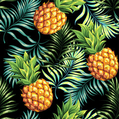 Pineapples are ripe, tropical with palm branches on a black background. Seamless vector pattern.