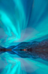 Wall Mural - Northern lights in the sky over Tromso,  Norway