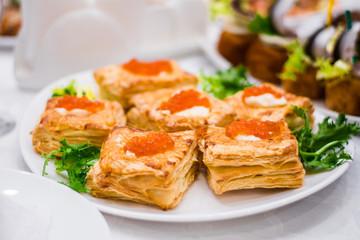 pancakes with salmon and red caviar bun patties