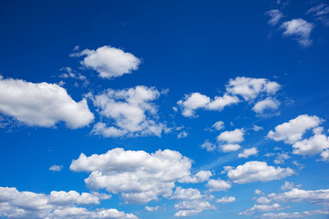 Blue sky with white clouds. Summer sky.