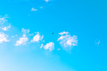 Beautiful Clouds against blue sky. Abstract Background. Blue sky with clouds and sun