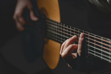 Close up on midsection of man Playing a guitar