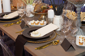 Close up of a fully set banquet table with brown and earth tones