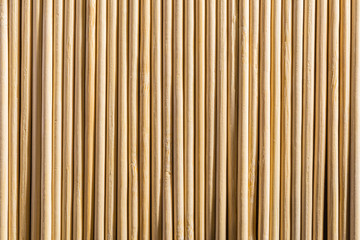 Round wooden sticks background. Close-up Wall Pattern