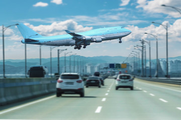 An airplane flying right up the road.