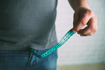 Guy measures penis size with tape measure or tape measure