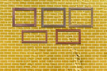 3D vintage photo frames on golden brick wall for interior or background.