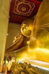 The famous reclining Buddha in Buddhist church in Phetchaburi, Thailand