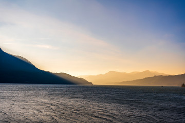 Mountain range illuminated by the oblique rays of the setting sun on the banks of the Columbia...