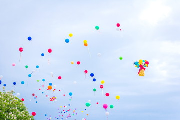 Multicolored balloons against the blue sky