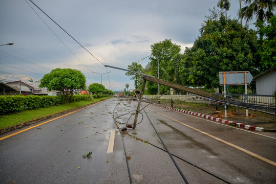 Storm of electric poles falling on the road