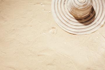 White sun hat on the sand.