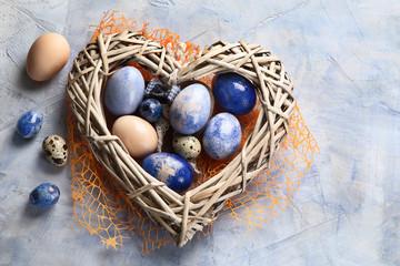 Easter eggs in heart shaped nest