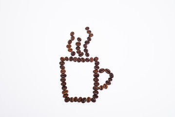 Coffee cup with foam made from coffee beans isolated on white