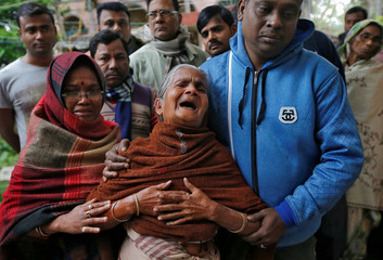 Elderly woman wails as she arrives at residence of Bablu Santra, a CRPF personnel who was killed after a suicide bomber rammed a car into the bus carrying CRPF personnel in south Kashmir on Thursday, at Bauria village in Howrah district