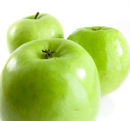 Apple green on a white background with other apples