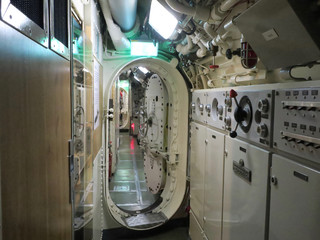 interior of an old submarine in the harbor of Den Helder