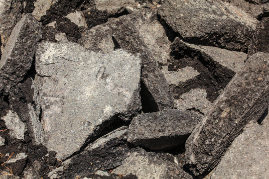 Discarded asphalt / concrete. Broken pieces laying on the sun.
