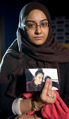 Renu Begum, sister of teenage British girl Shamima Begum, holds a photo of her sister as she makes an appeal for her to return home at Scotland Yard, in London