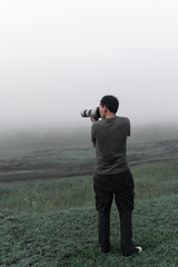 Gay in yhe  fog with a camera