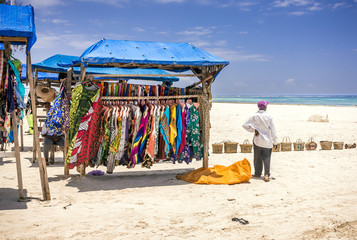 Wooden stall with colorful fabrics on Diani beach eascape, Kenya Wall mural
