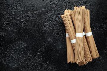 Noodles soba, buckwheat on black background. Traditional Japanese food.
