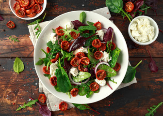 Sun dried tomatoes Salad with fresh vegetables mix and mozzarella cheese. healthy food