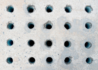 Drain cover made of cement with many PVC pipe for evaporation of pressure from the drain.