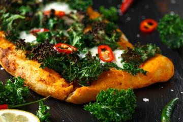 Homemade Kale and red chilli flatbread pizza with mozzarella