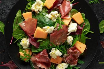 Parma ham and melon salad with mozzarella, green leaves mix