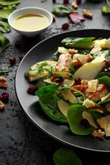 Pear, chicken salad with cheddar cheese, cranberry and walnuts. healthy food