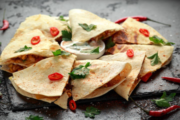 Mexican quesadilla with chicken, cheese and peppers, yogurt dip and chilli.