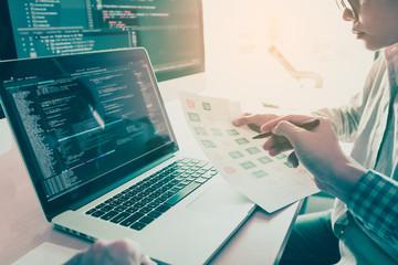 Two people coding code program programming developer computer web development coder working design software on desk in office.