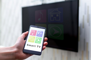 Online control TV by wifi using a mobile app on smartphone. Smart TV and home