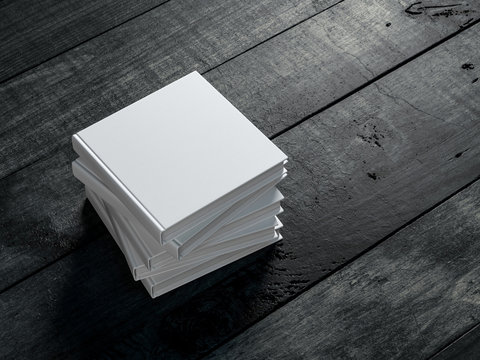 Stack of Square white Books Mockup with hard cover on wooden table