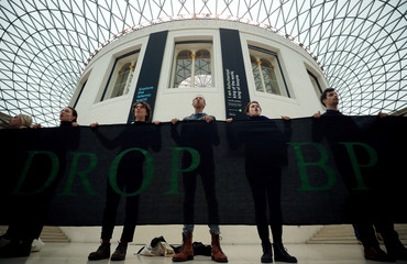 Demonstrators hold a banner during a protest over BP and Iraq at the British Museum in London
