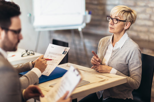 Senior woman,  job applicants having interview