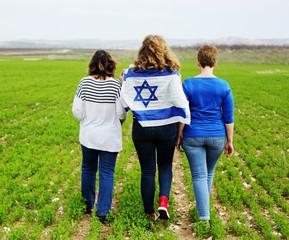 Women holding an Israeli flag