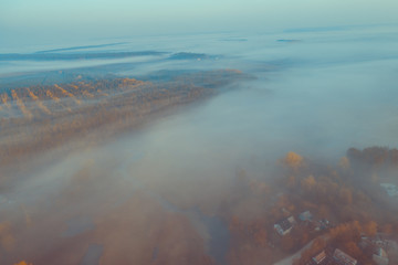 Early foggy morning. Aerial view of countryside and country road