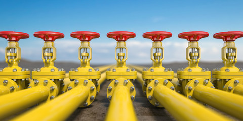 Yellow gas pipe line valves. Oil and gas extraction, production  and transportation industrial background.