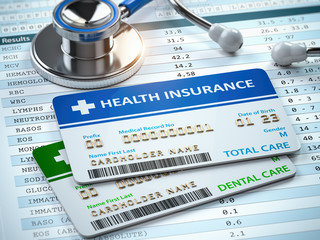 Health Insurance cards total and dental care with stethscope.