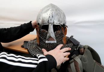 A competitor of Buhurt Prime checks his helmet before the tournament of medieval martial fights in real armours and steel swords in Monaco
